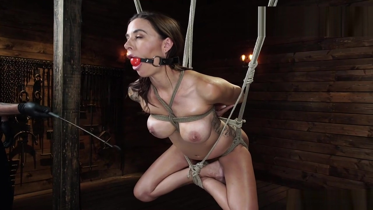 Tight tied busty slave caned on hogtie