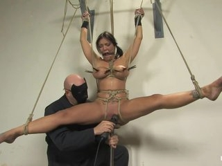 Masked Guy Exposes Busty Brunette To Various Bdsm Tortures